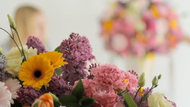 Florists make a huge bouquet from a variety of colorful flowers