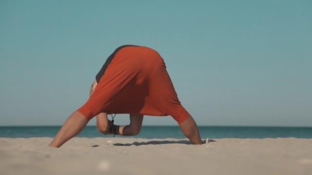 Yoga power exercise on the wild beach