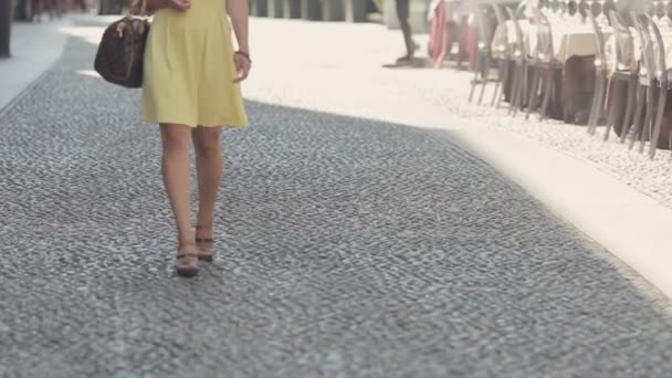 Confident woman walks on courtyards of Milan