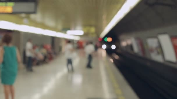 Blurred people waiting for subway at station of Milan