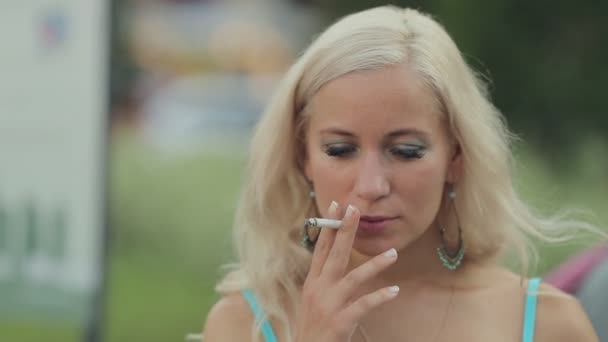 Woman smoking a cigarette on the street