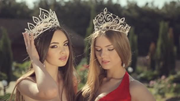 Two young winners of the beauty contest in the crown in the park