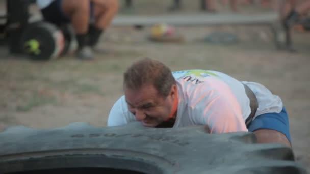 Athlete Pushes Huge Wheel