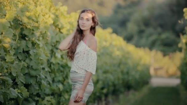 Cute girl posing near the vine