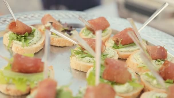 Sandwiches with cream cheese, leaf of lettuce and a piece of ham on catering