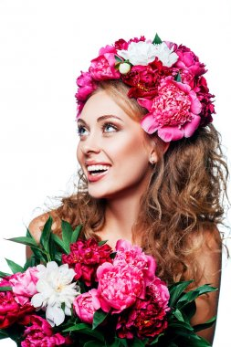 Fashion Beauty Model Girl with flowers in the hair