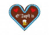 Besticktes Wiesn-Lebkuchenherz mit Bierkrug und Edelweißblume. o zapft is heißt, das Bierfass wird angezapft.