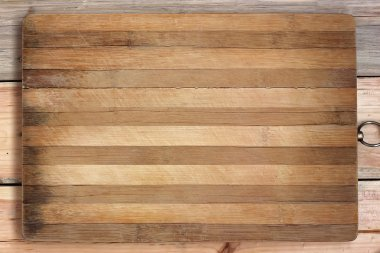 Chopping board in a strip on a wooden table