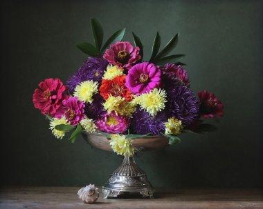 Autumn flowers in an iron vase