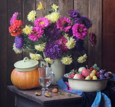 Big still life with autumn flowers and fruits
