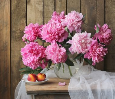 Still life with a bouquet of peonies.