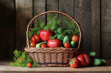 Basket with cucumbers and tomatoes.