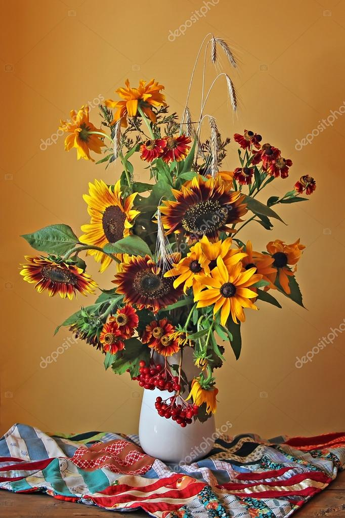 Still life with a bouquet of  yellow and red flowers on a bright