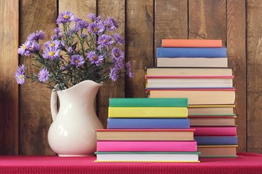 Still life with books and a bouquet.