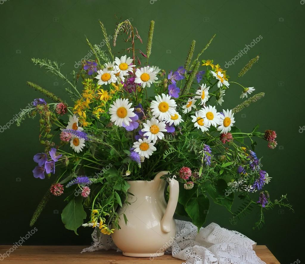 Still life with a bouquet of wild flowers. Camomiles.