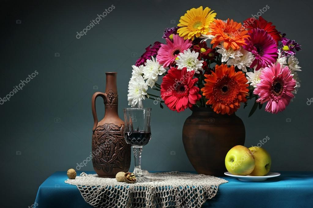 Still life with a bouquet and wine. Transvaal daisies.