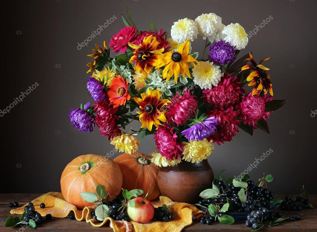 Autumn still life with flowers and fruits.