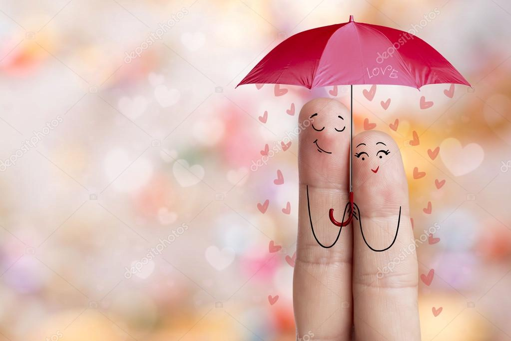 Finger art. Lovers is embracing and holding red umbrella. Stock Image