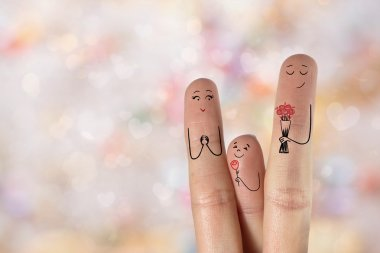 Conceptual family finger art. Father and son are giving bouquet
