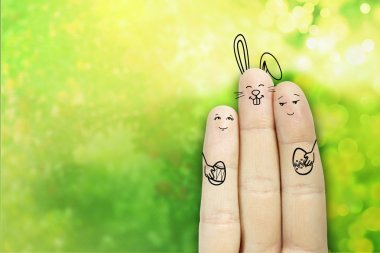 Conceptual Easter Finger Art. Couple With Bunny Are Holding Painted Eggs. Stock Image
