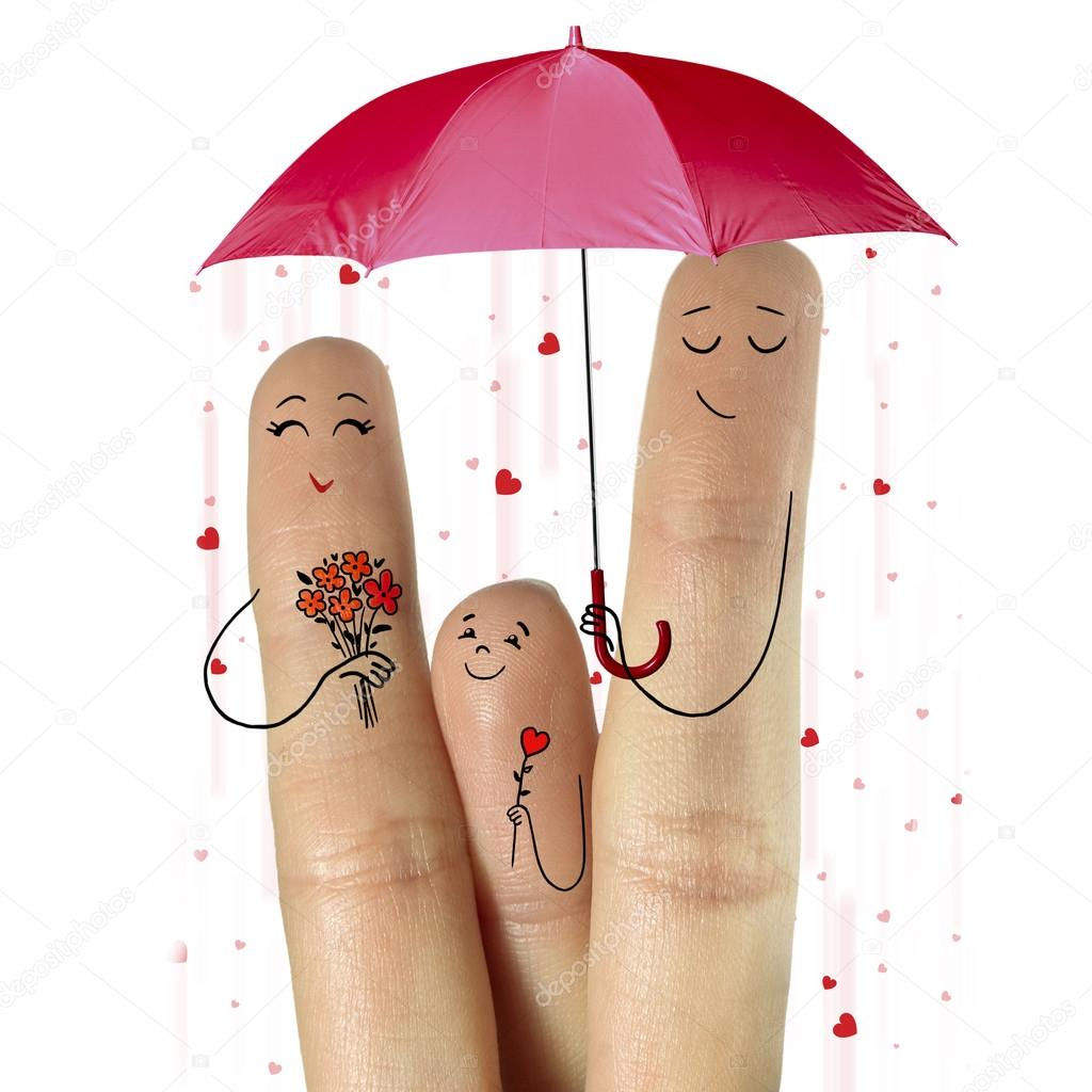 Father, and son are giving flowers their mother staying under umbrella with falling hearts