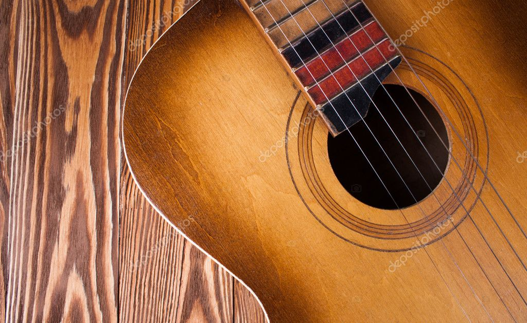 Guitar on wood desk