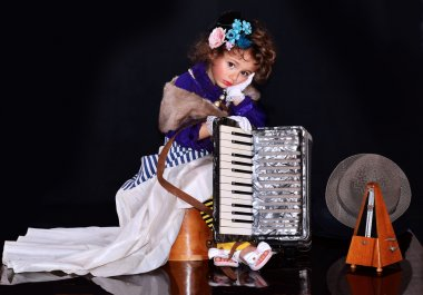 Cute baby with an accordion