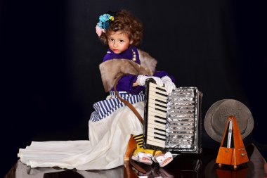 Cute little girl with an accordion