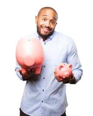 black businessman with pink piggybanks