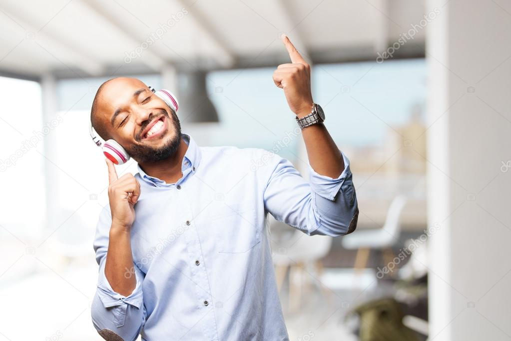 black man listening music on headphones stock photo kues 109258928