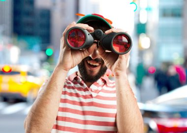 crazy young man with binoculars