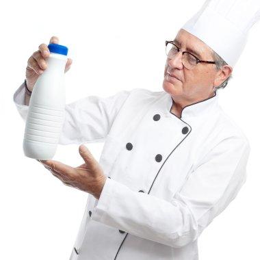 Senior cool man with milk bottle