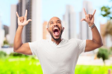 young cool black man  celebrating sign