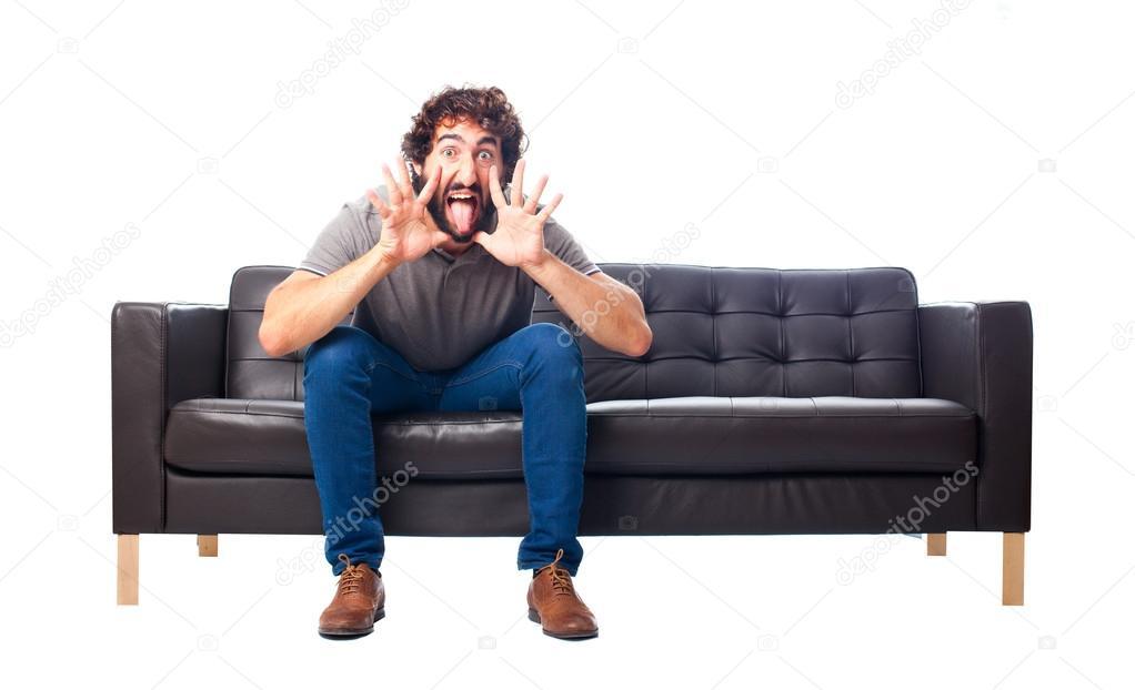 Verrückte Sofas verrückte jüngling auf einem sofa stockfoto kues 65272899