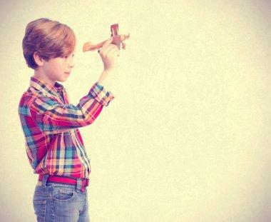 Boy throwing a wood plane