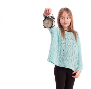 Young girl with an alarm clock
