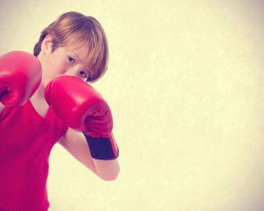 Concentrated child with a boxing gloves
