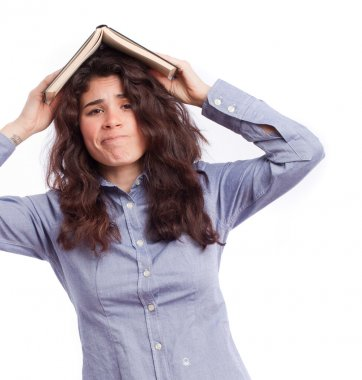 Concerned student with a book on her head