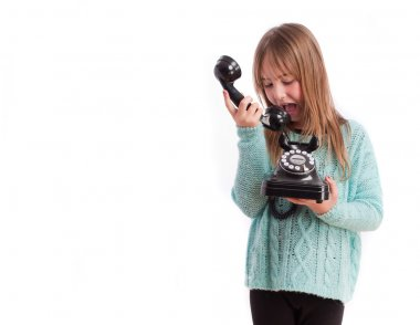 Young girl with a telephone