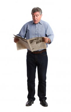 Angry man reading a newspaper