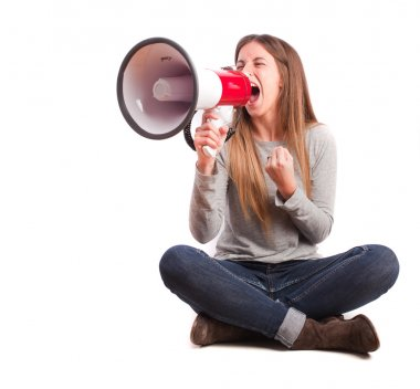 Angry girl shouting with a megaphone