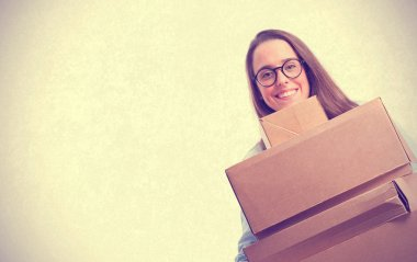 young woman holding a cardboard boxes