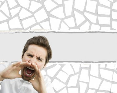 Man shouting over torn paper background