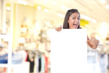 girl with a poster in a shopping center