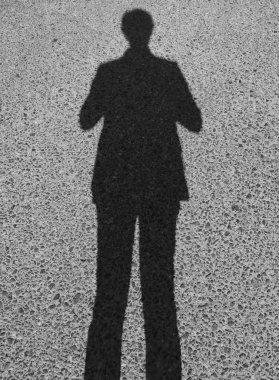 man shadow in asphalt