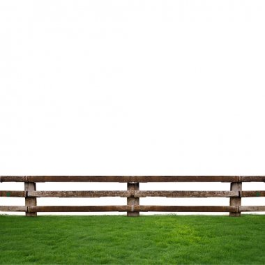 Wooden fence in green grass meadow