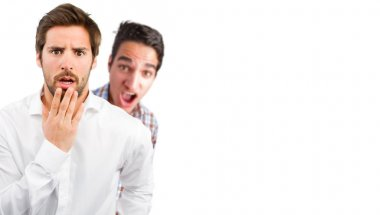 two young men in surprised pose