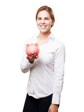 blond woman with a piggy bank