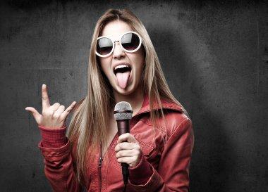 blond woman singing
