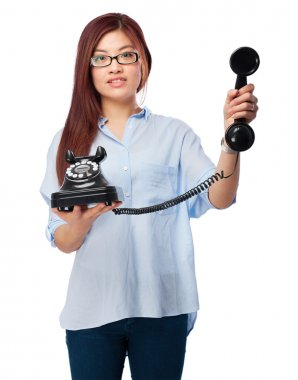 Happy chinese woman with telephone
